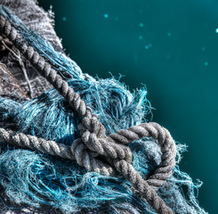 Tied rope on a fisherman net by the sea in hdr