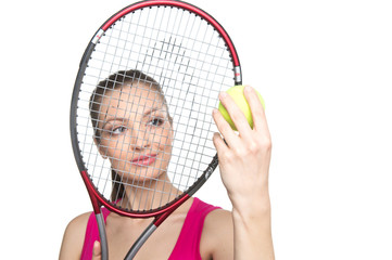 Portrait of young woman with tennis racket isolated on white.