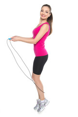 Young girl with skipping rope on white background.