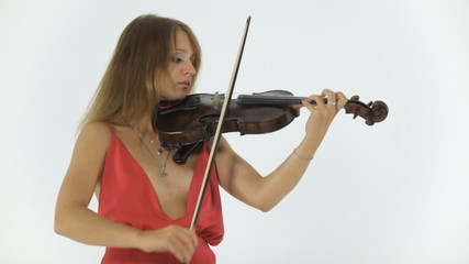 Talented girl in a long dress emotionally plays the violin