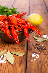 Boiled crawfish on wooden table