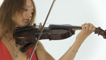 Young violinist playing on her a musical instrument