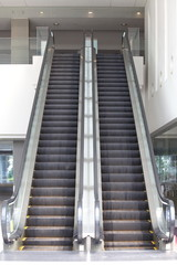 Empty escalator stairs in the modern office