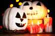 Halloween white pumpkins and candles