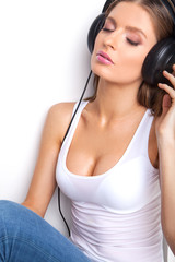 sexy babe in white shirt and headphones listening music