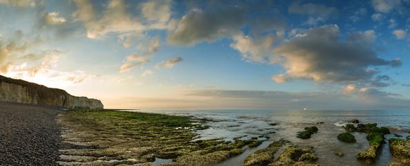 Beautiful landscape panorama sunset over rocky coastline