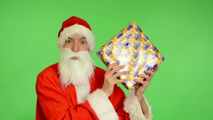 green screen -- Santa Claus gets a gift and is surprised