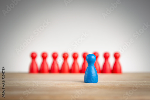 canvas print picture Stand out and be unique - leadership business concept with pawns