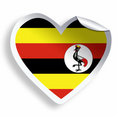 Heart sticker with flag of Uganda isolated on white