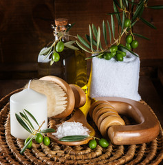 Spa and wellness setting with olive fruits