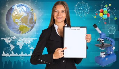 Beautiful businesswoman holding paper holder. Earth, microscope
