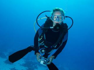 Female scuba diver and underwater photographer