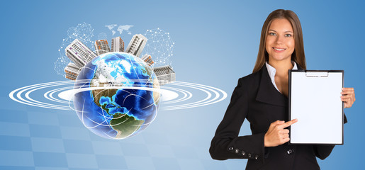 Beautiful businesswoman holding paper holder. Earth with