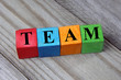 concept of team word on wooden colorful cubes