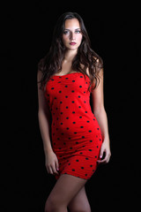 Striking well-proportioned model in red polka dot dress