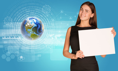 Beautiful businesswoman holding paper holder. Earth with figures