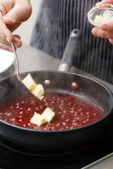 chef making sauce