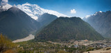 Lower Pisang village on a Annapurna Circuit in Himalayas poster