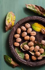 Walnuts in rustic bowl