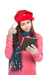 Asian girl with red christmas hat and tablet PC