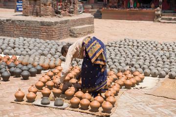 Unidentified pottery woman near Bhaktapur durbar square