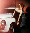 sexy stylish blond model in retro style near old car