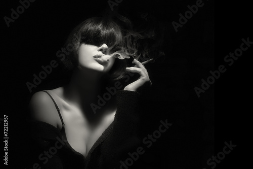 Smoke. Beauty Fashion Model Smoking a Cigarette - 72212957