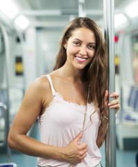 Girl passanger inside train