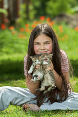 Happy little girl  with a little cat