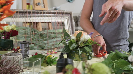Tracking shot of florist preparing a composition for a wedding