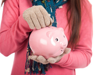 Asian girl with red christmas hat ,coin and piggy bank