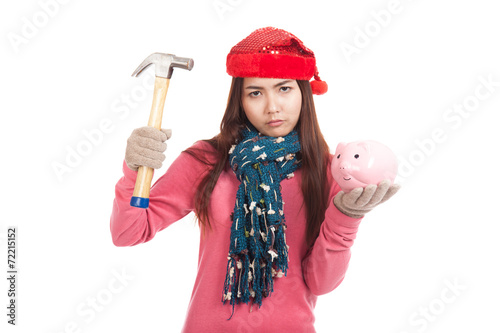 Poster Asian girl with red christmas hat ,hammer and piggy bank