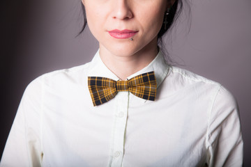 Girl brunette office worker with bow tie