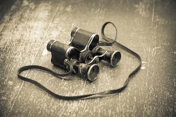 Old vintage binoculars, retro style. Black - white photo