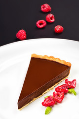 Delicious Piece of Sweet chocolate pie  with fresh red berries o