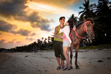 Vacation Lifestyles. Couple Horseback Riding at Sunset