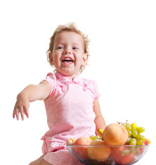 Little Girl Eating Fruit. Isolated on White