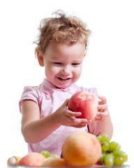Little Girl Eating Fruit. Isolated on White