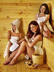 Friend relaxing in sauna.