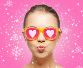 smiling teenage girl in pink sunglasses