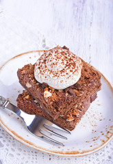 Chocolate cake with nuts and whipped cream