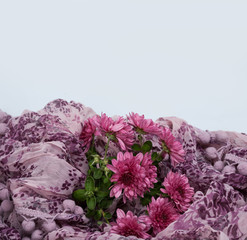 violet bouquet left in pink scarf