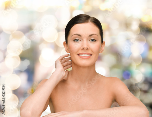 canvas print picture smiling young woman with bare shoulders