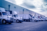 Trucks lorrys loading unloading at warehouse poster
