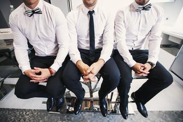 Three men in white shirts