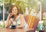 Happy woman at outdoor restaurant