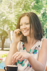 Attractive woman chatting on a mobile