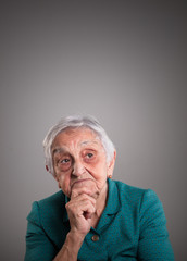 Old woman thinking with copy space above