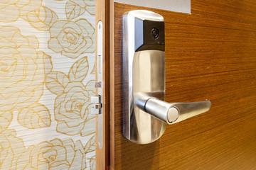 Electronic door knob on wooden door