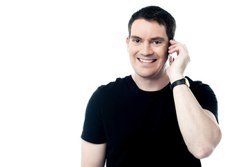 Casual smiling man calling on the phone